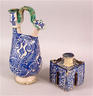 A 19TH CENTURY NORTH AFRICAN MOROCCAN POTTERY EWER,