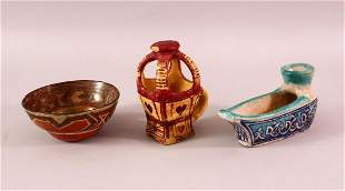 THREE NORTH AFRICAN POTTERY ITEMS, including a circular