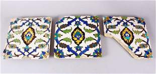 A SET OF THREE EARLY SAFAVID POTTERY TILES, each with