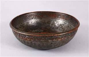 A UNUSUAL ISLAMIC TINNED HAMMERED COPPER CALLIGRAPHIC