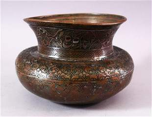 A 17TH CENTURY INDIAN TINNED COPPER SPITTOON, with