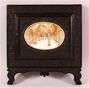 A GOOD INDIAN CARVED EBONY & PAINTED frame, the frame