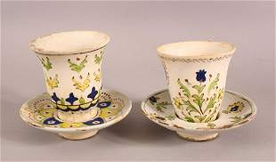 TWO TURKISH CUPS & SAUCERS - with floral motif
