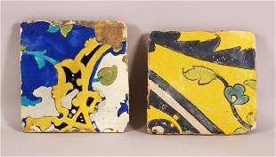 TWO ISLAMIC / PERSIAN POTTERY TILE SECTIONS - 21CM &