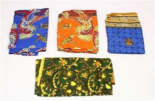 FOUR COLOURFUL PRINTED COTTON TEXTILES, various sizes