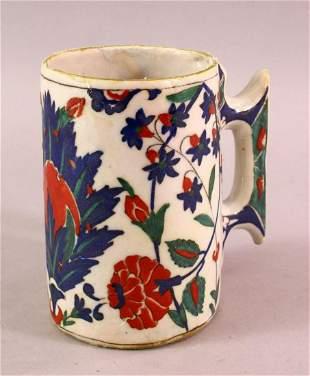 AN 18TH CENTURY TURKISH OTTOMAN IZNIK CUP / MUG, with a