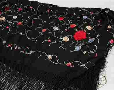 AN EMBROIDERED SHAWL