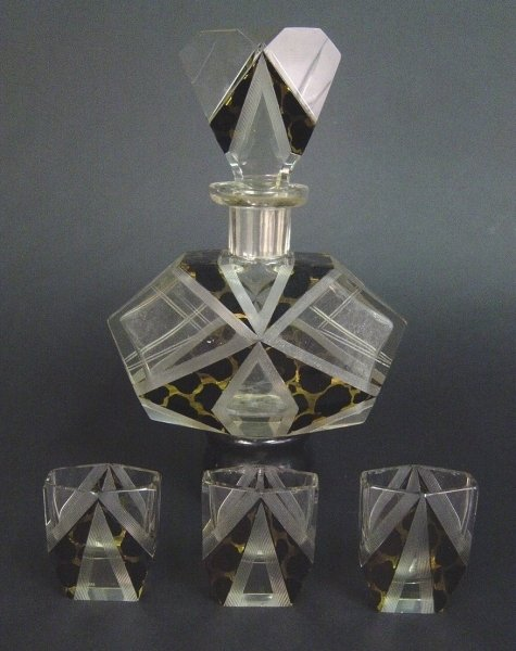 2002: AN ART DECO LIQUEUR DECANTER AND THREE MATCHING