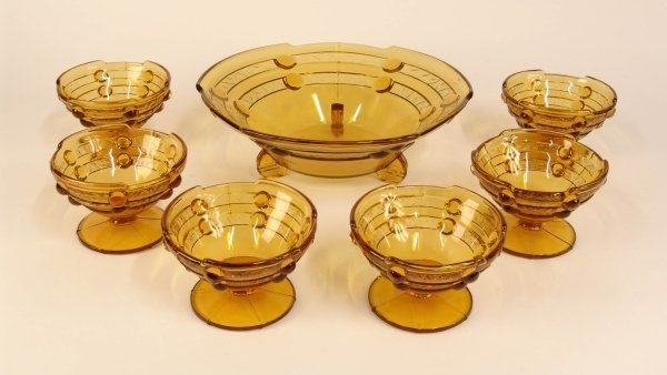 2024: A MOULDED AMBER GLASS DECO-STYLE BOWL with six ma