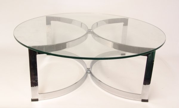 2388: WILLIAM PLUNKETT A chrome and glass coffee table,