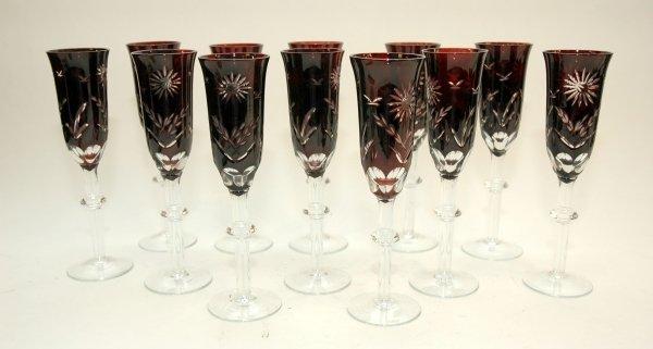 1: A SET OF TWELVE BOHEMIAN RUBY CUT GLASS CHAMPAGNE GL
