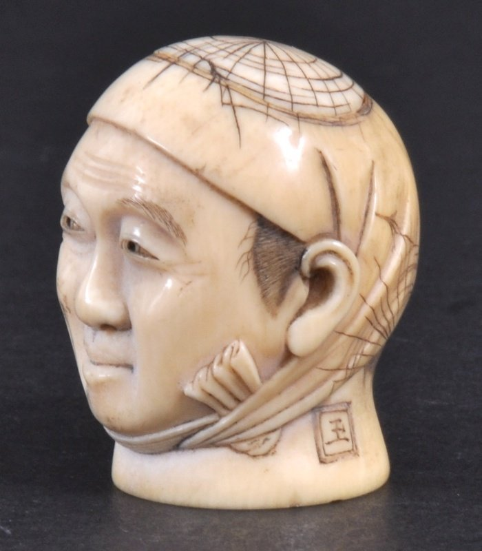 5: A LATE 19TH CENTURY JAPANESE CARVED IVORY HEAD depic
