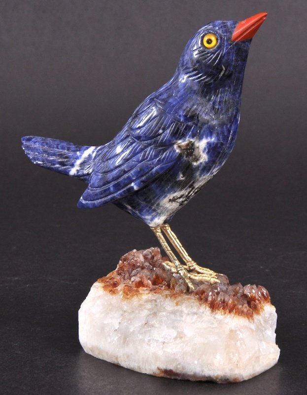 7:   A LAPIS MODEL OF A BIRD on a rock crystal base, in