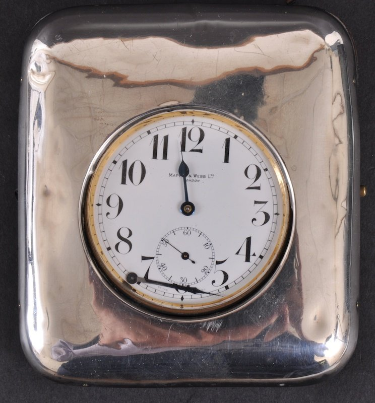 11: A LARGE MAPPIN & WEBB POCKET WATCH in a folding sil