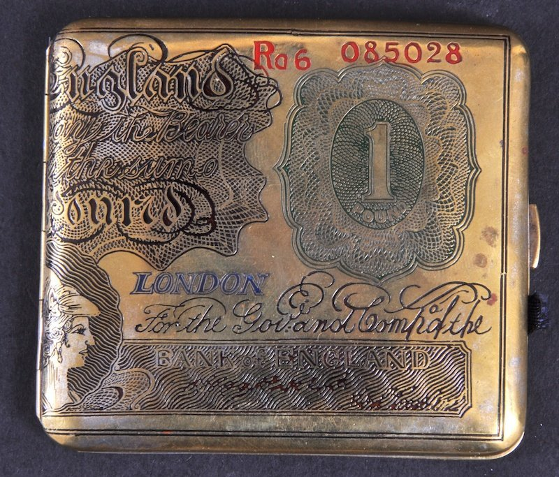 15: A GILT CIGARETTE CASE as a one pound note.