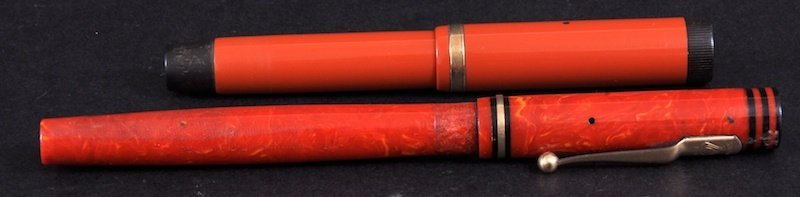 107: A SWAN 2 RED FOUNTAIN PEN AND A PARKER DUOFOLD FOU