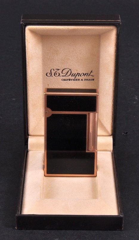 113: A DUPONT BLACK ENAMEL LIGHTER in original box.