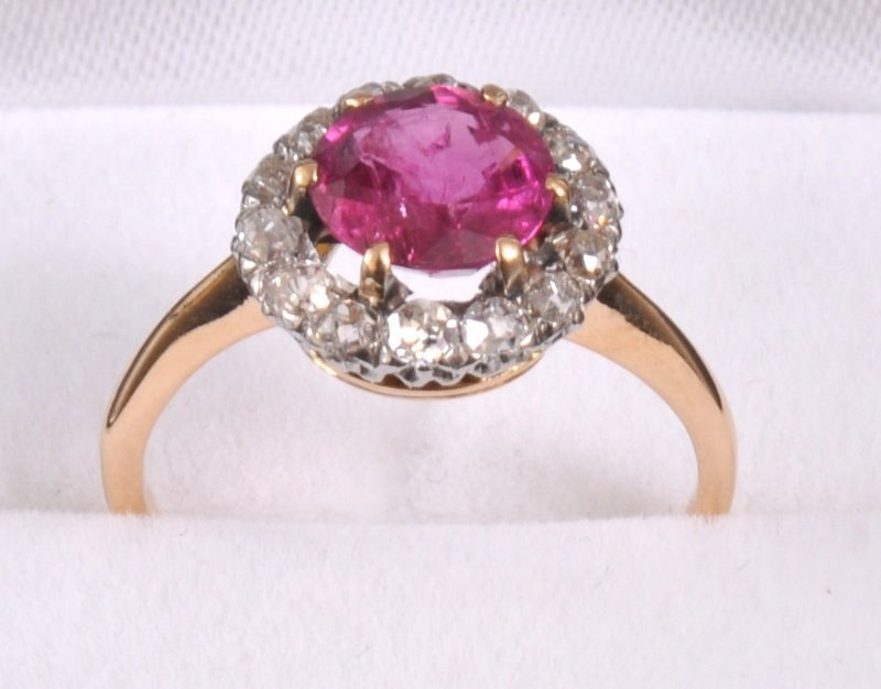 205: A YELLOW GOLD RUBY AND OLD CUT DIAMOND CLUSTER DRE