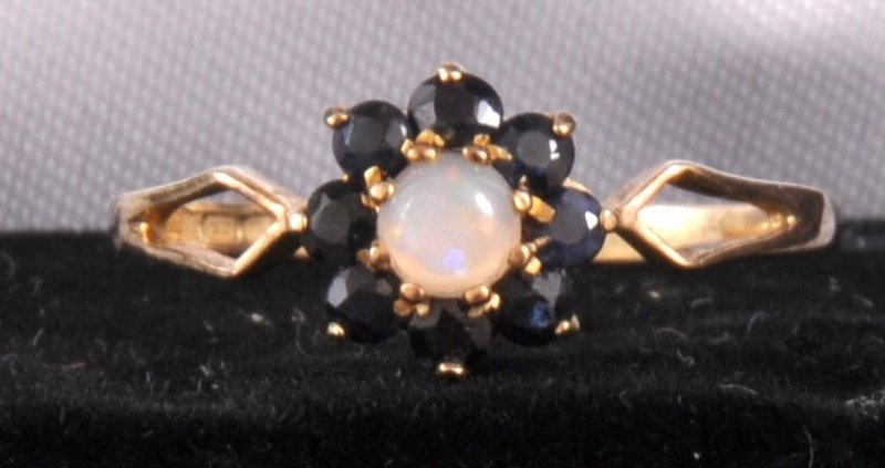 213: A SMALL SILVER GILT OPAL AND SAPPHIRE CLUSTER DRES