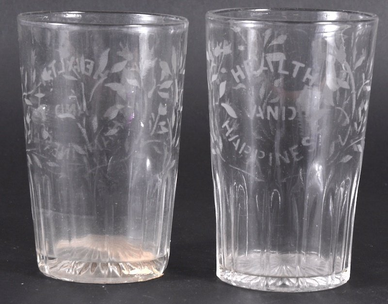 829: A PAIR OF HEALTH AND HAPPINESS ENGRAVED TUMBLERS.
