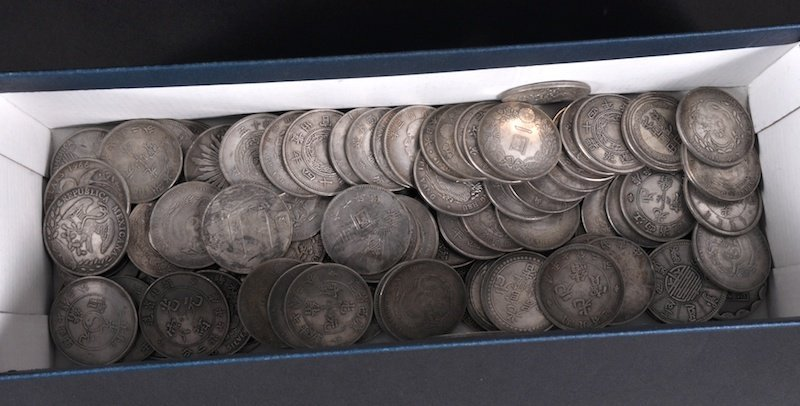 1128: A BOX OF 100 CHINESE COINS.