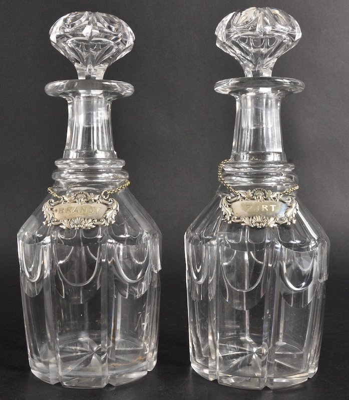 810: A PAIR OF LATE 19TH CENTURY GLASS DECANTERS with b