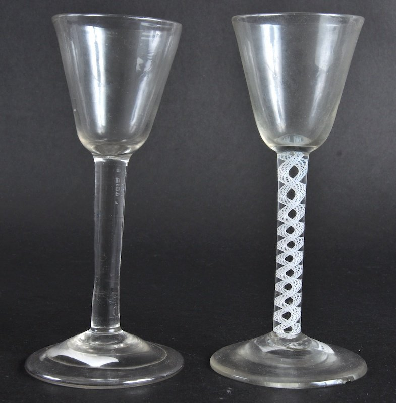813:  A GEORGE III WINE GLASS with white spiral twist,