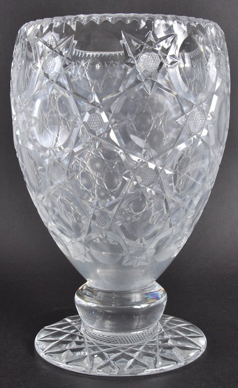 816: A STAR CUT GLASS VASE (chip in base) 12ins high.