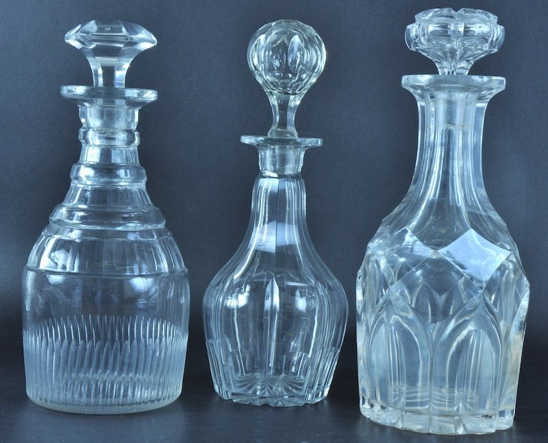 818: A GEORGE III CUT GLASS MALLET DECANTER together wi