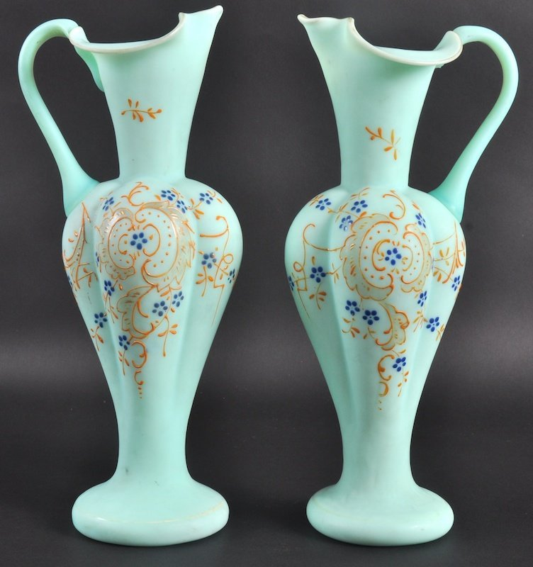 954: A PAIR OF LATE VICTORIAN OPALINE GREEN GLASS EWERS