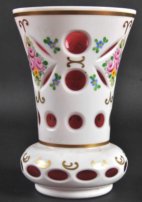 956: AN EARLY 20TH CENTURY BOHEMIAN RUBY GLASS VASE wit