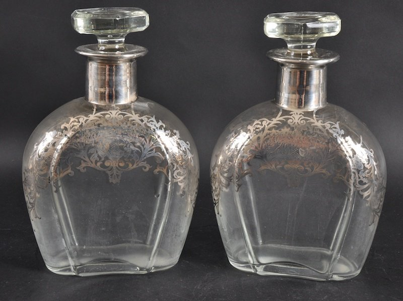 966: A PAIR OF SILVER OVERLAID GLASS DECANTERS AND STOP