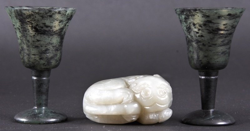 412: A CHINESE GREEN JADE CARVED FIGURE OF A BEAST toge