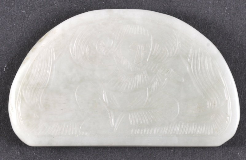 652:  A CHINESE CARVED GREEN HETIAN JADE PLAQUE possibl
