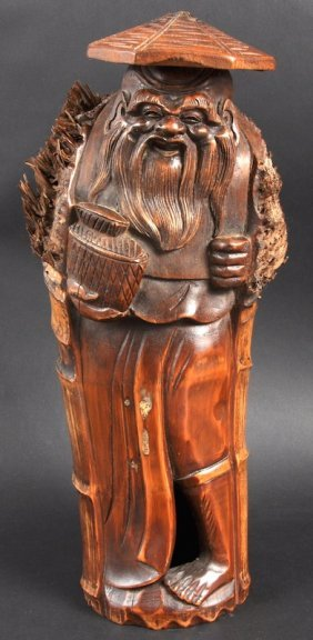 A 19TH/20TH CENTURY CHINESE CARVED BAMBOO FIGURE OF
