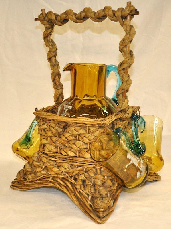 756: A MARY GREGORY LEMONADE SET in a wicker basket.