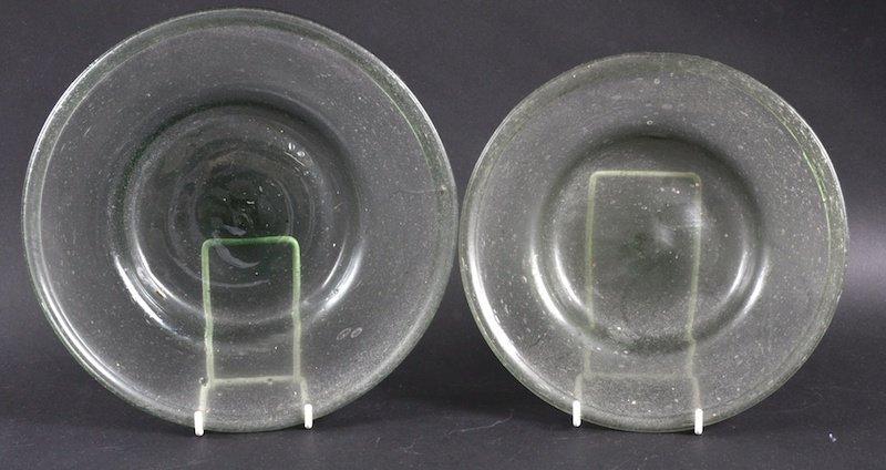 757: A 17TH/18TH CENTURY GREEN GLASS CIRCULAR DISH toge