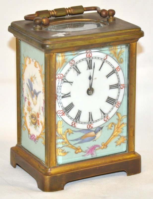 771: A FRENCH CARRIAGE CLOCK with four porcelain panels