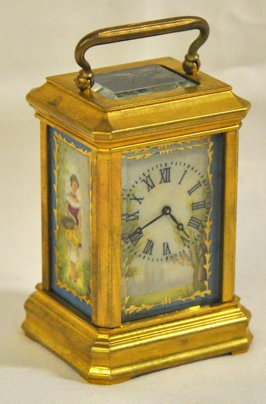 772: A MINIATURE FRENCH CARRIAGE CLOCK with four porcel