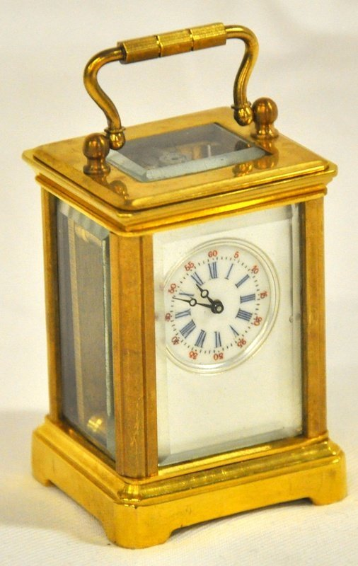 773: A MINIATURE FRENCH BRASS CARRIAGE CLOCK. 2. 25ins