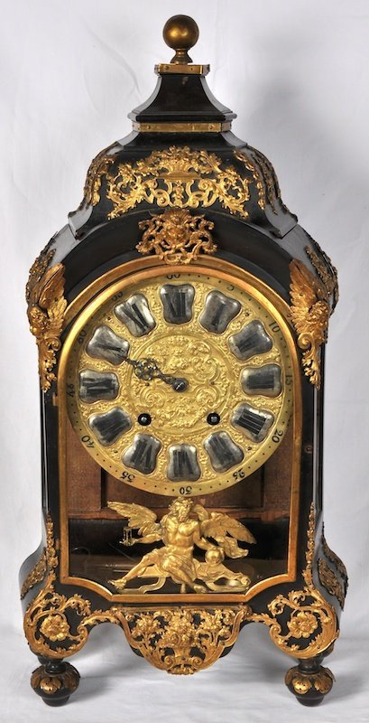782:  AN 18TH CENTURY FRENCH ORMOLU MOUNTED CLOCK ON BR