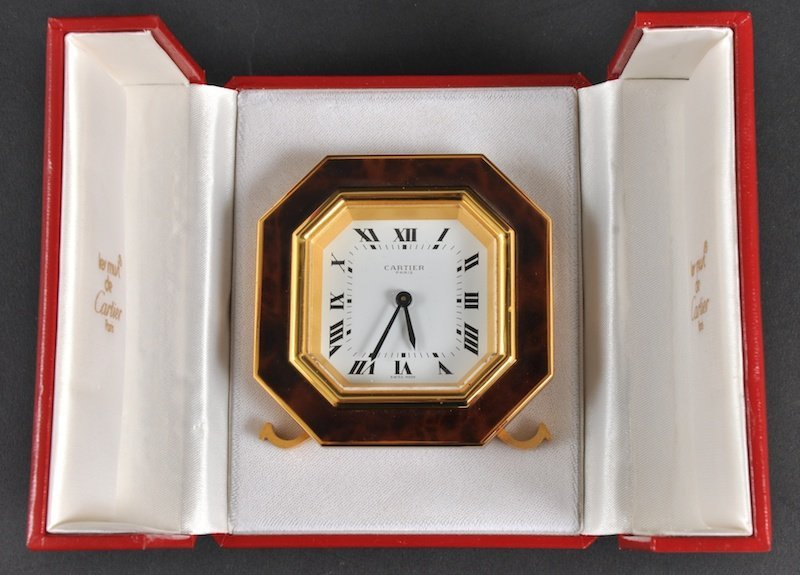 1873: A CARTIER OCTAGONAL TRAVELLING CLOCK in original