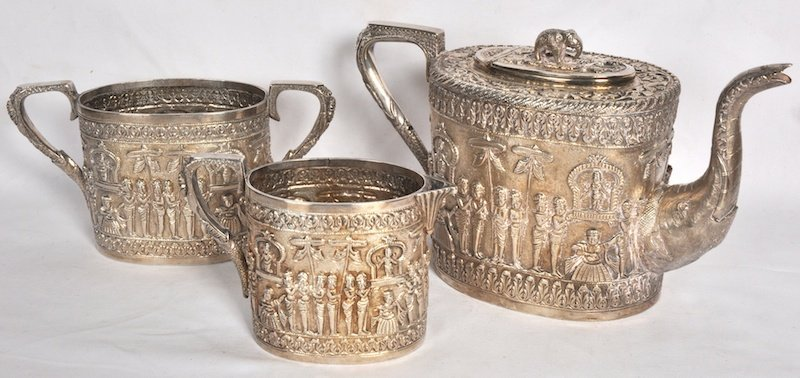 2223:  AN INDIAN OVAL THREE PIECE TEA SET, repousse wit