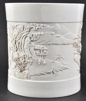 10:  A CHINESE WHITE GLAZED BRUSH POT bearing Qianlong