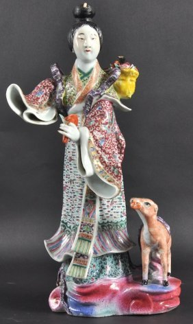 20:  A 19TH CENTURY CHINESE CANTON ENAMEL FIGURE OF GUA
