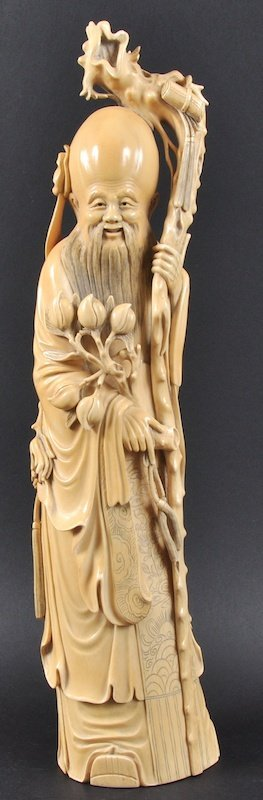 A LATE 19TH CENTURY CHINESE CARVED IVORY FIGURE OF SAGE