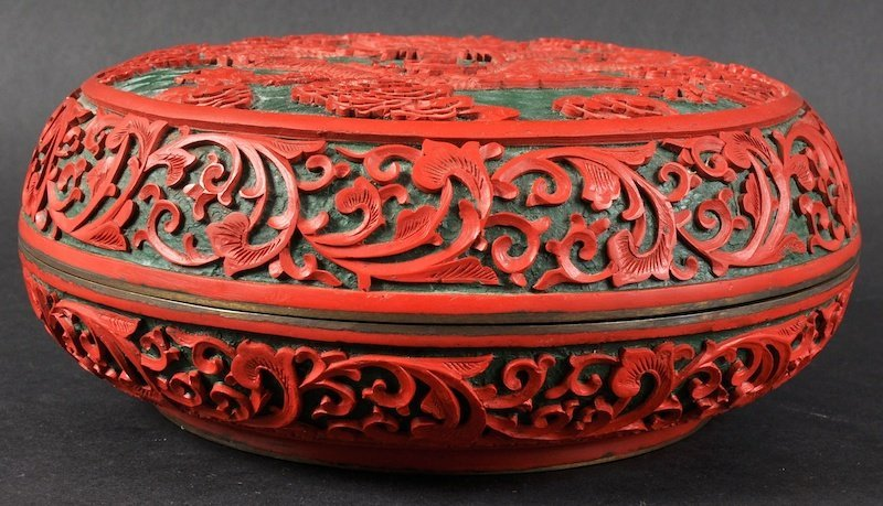 AN EARLY 20TH CENTURY CHINESE CINNABAR LACQUER CIRCULAR