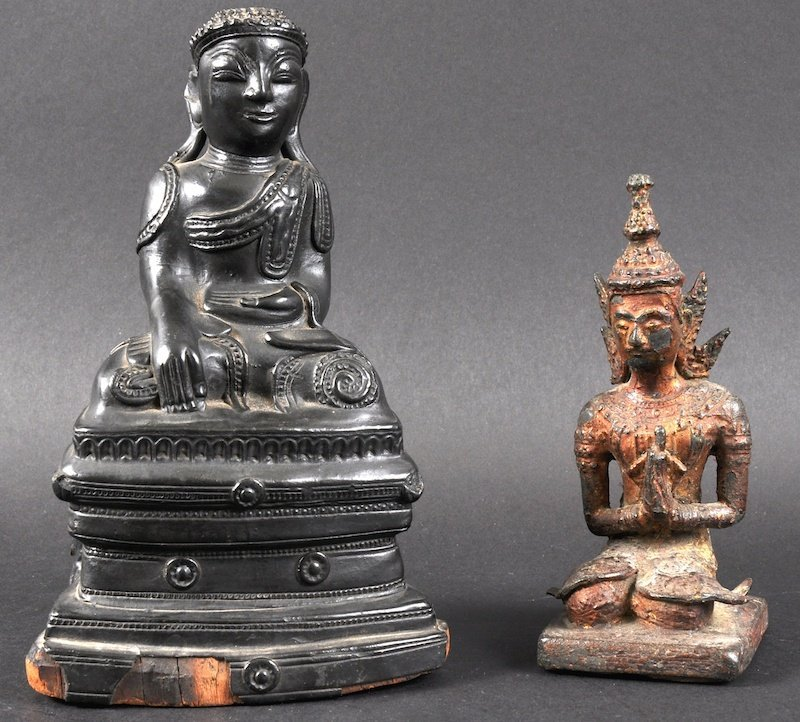 AN 18TH CENTURY SOUTH EAST ASIAN LACQUERED BRONZE BUDDH