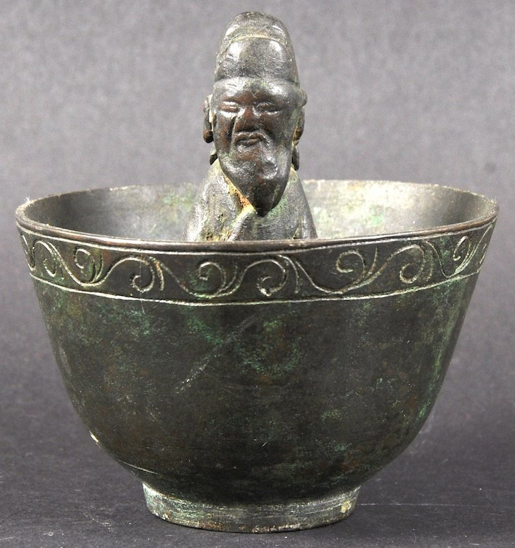 AN EARLY CHINESE BRONZE CIRCULAR BOWL possibly late Mi