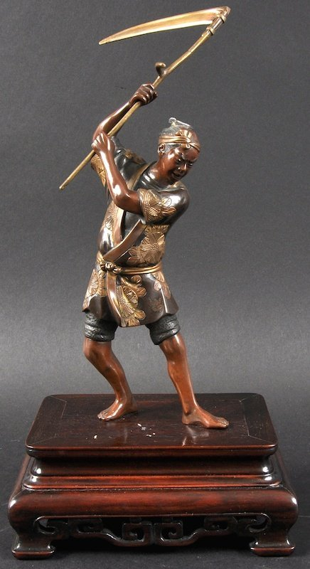 A 19TH CENTURY JAPANESE MEIJI PERIOD BRONZE FIGURE OF
